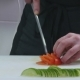 Man in the Kitchen Cutting Tomato - VideoHive Item for Sale