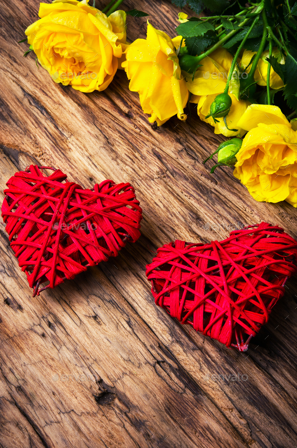 Spring flowers and symbolic red hearts - Stock Photo - Images