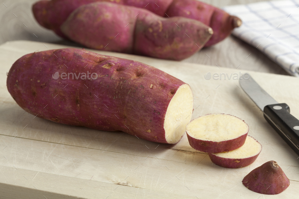 Purple sweet potatoes with slices - Stock Photo - Images