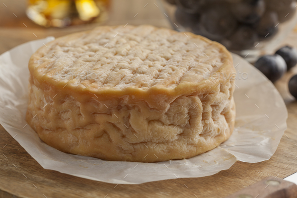 Whole Epoisses cheese close up - Stock Photo - Images