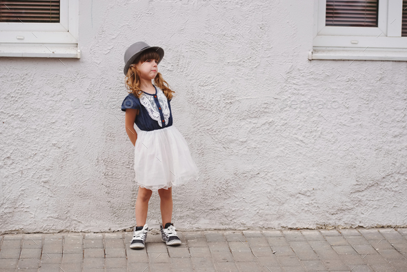 cute little capricious girl on the street - Stock Photo - Images