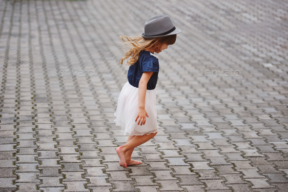 little beautiful barefoot girl in park - Stock Photo - Images