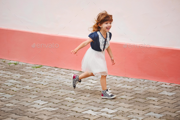 young happy girl running away - Stock Photo - Images
