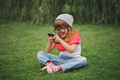 little girl with mobile phone on the grass - PhotoDune Item for Sale