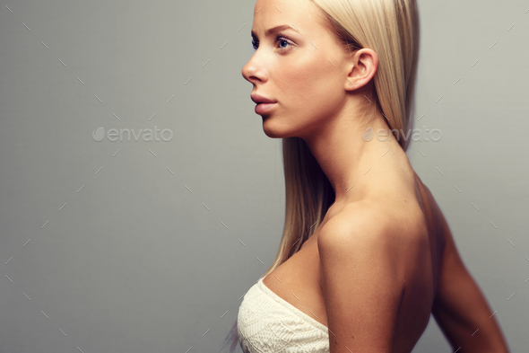 Fashion portrait of a blonde woman in with attitude - Stock Photo - Images