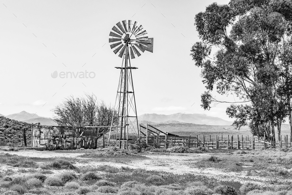 Windmill, dam and a kraal. Monochrome - Stock Photo - Images