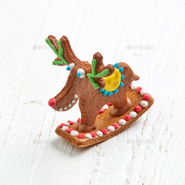 gingerbread deer on white wooden table - Stock Photo - Images