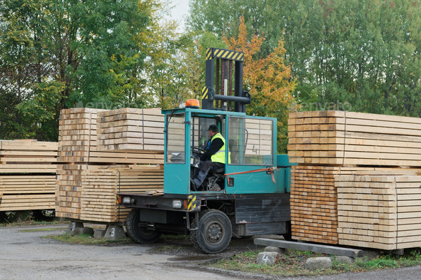 Forklift transports the boards at the plant for woodworking. Woodworking industry - Stock Photo - Images
