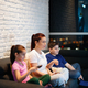 Single Mother And Children Watching TV At Night - PhotoDune Item for Sale