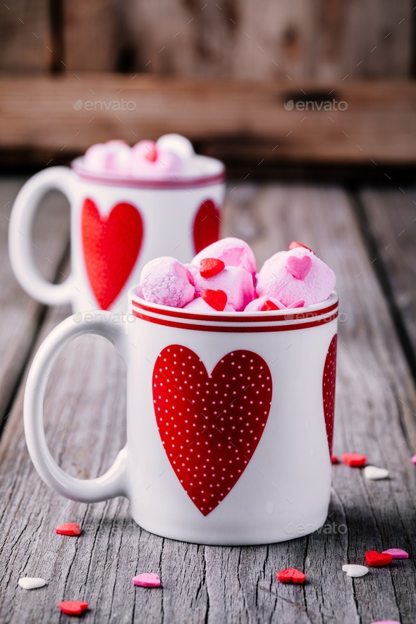Hot coffee with pink marshmallow in mugs with hearts for Valentine's day - Stock Photo - Images