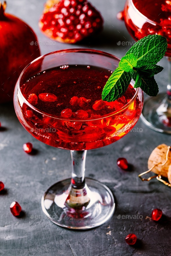red cocktail with champagne and pomegranate seeds - Stock Photo - Images