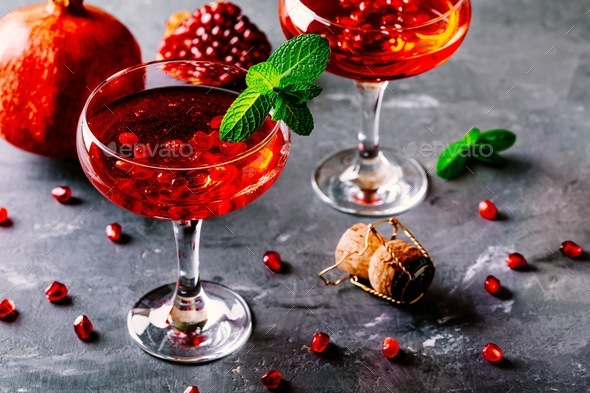 red cocktail with sparkling wine and pomegranate seeds - Stock Photo - Images