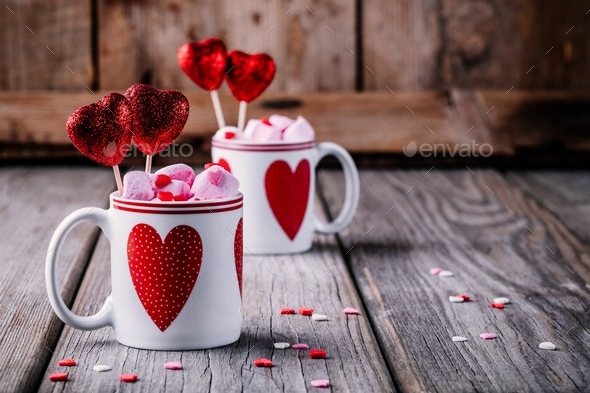 Hot chocolate with pink marshmallow in mugs with hearts for Valentine's day - Stock Photo - Images