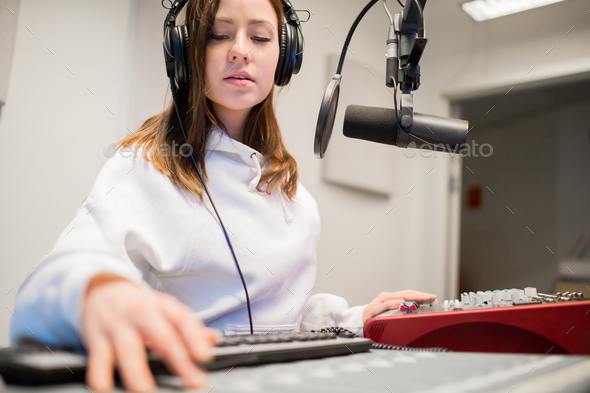 Radio Jockey Wearing Headphones In Studio - Stock Photo - Images