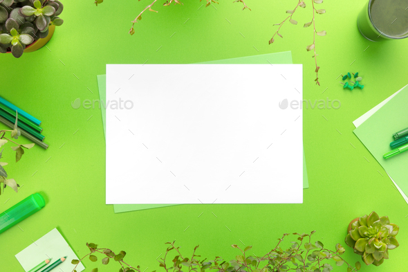 Environmental concept of a green office desk with supplies - Stock Photo - Images
