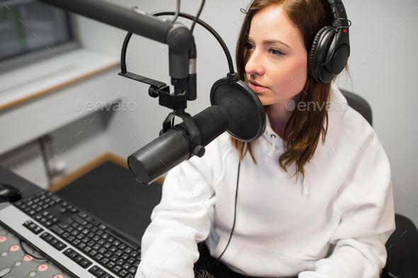 High Angle View Of Radio Jockey Communicating On Microphone - Stock Photo - Images