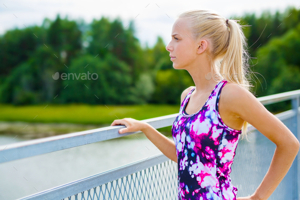 Thoughtful young woman rests after training - Stock Photo - Images