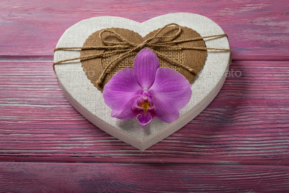 Gift box in the shape of a heart and Orchid - Stock Photo - Images
