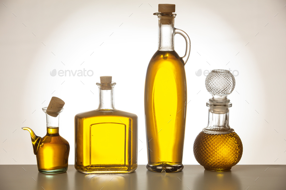 Set of bottles with olive oil on gradient background - Stock Photo - Images