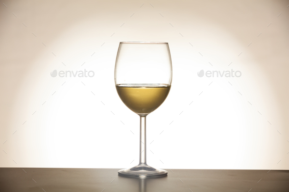 Glass of wine on gradient background - Stock Photo - Images