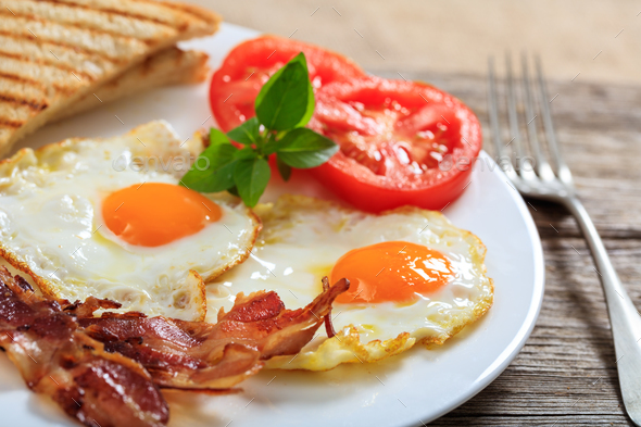 Fried eggs and bacon - Stock Photo - Images