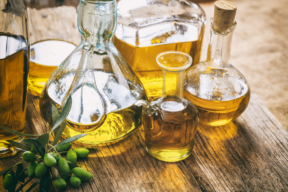 Bottles of olive oil on a table - Stock Photo - Images