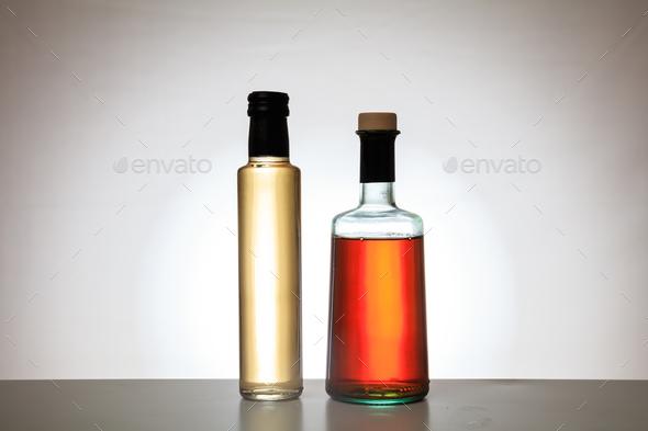 Bottles of vinegar on gradient background - Stock Photo - Images