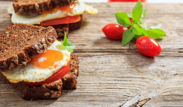 Fried egg and tomato sandwich - Stock Photo - Images