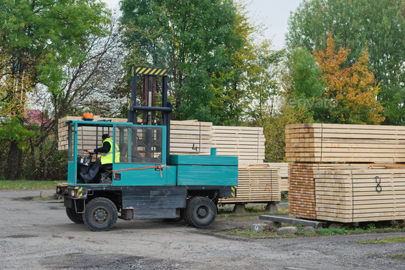 Forklift transports the boards at the plant for woodworking - Stock Photo - Images