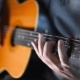 Guitar Player Plays Scales and Gamms on the Acoustic Western Guitar - VideoHive Item for Sale