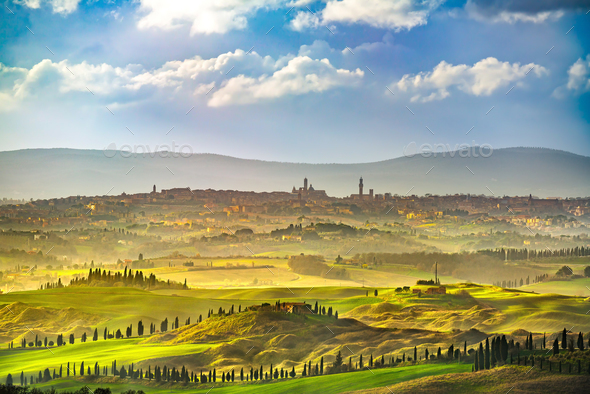 Siena city skyline, countryside and rolling hills. Tuscany, Ital - Stock Photo - Images