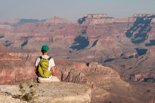 Tourist with backpack at Grand Canyon - Stock Photo - Images