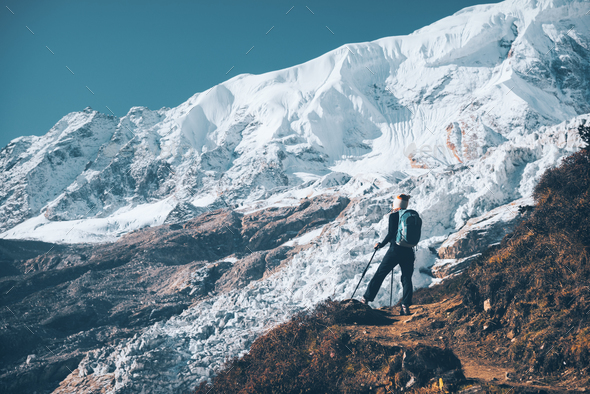Woman with backpack on the mountain peak - Stock Photo - Images