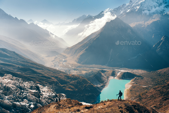 Woman looking on the lake and mountain valley - Stock Photo - Images