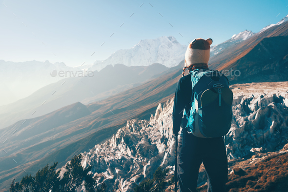 Landscape with girl and mountains in Nepal - Stock Photo - Images