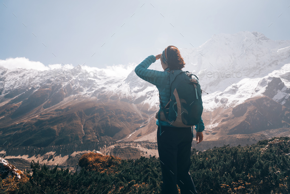 Woman with backpack looking on beautiful mountains - Stock Photo - Images