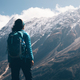 Woman with backpack looking on beautiful mountains - PhotoDune Item for Sale