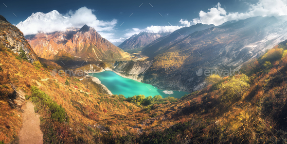 Himalayan mountains and lake with turquoise water at sunset - Stock Photo - Images