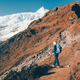 Woman with backpack on the mountain trail - PhotoDune Item for Sale