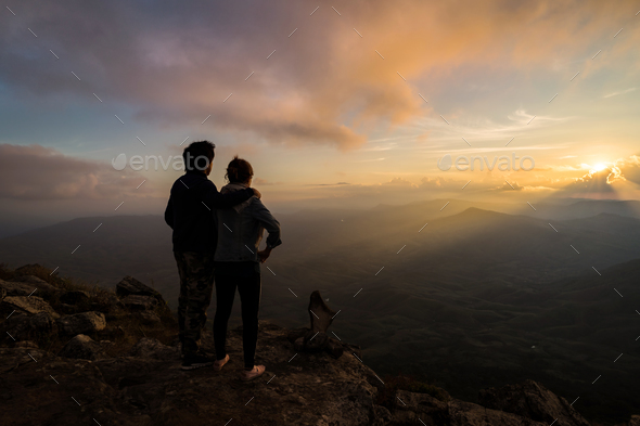 Silhouette of loving couple embracing on the mountain - Stock Photo - Images