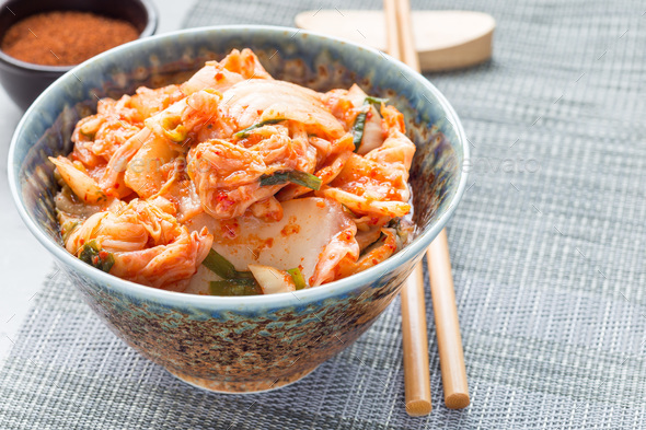 Kimchi cabbage. Korean appetizer in bowl, horizontal, copy space - Stock Photo - Images