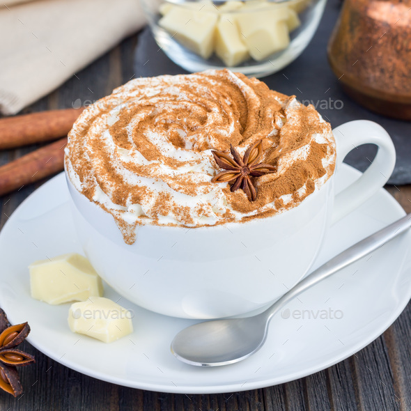 Hot white chocolate, decorated with whipped cream and cinnamon, square format - Stock Photo - Images
