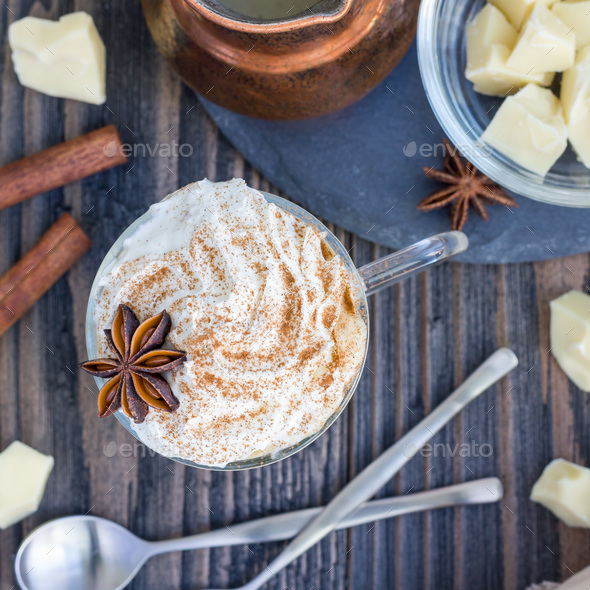 Hot white chocolate, decorated with whipped cream and cinnamon, top view, square - Stock Photo - Images