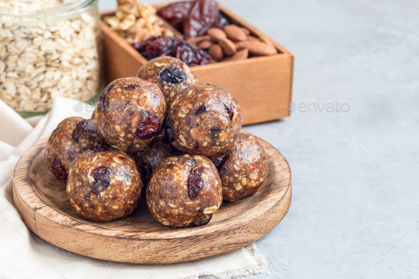 Healthy homemade energy balls on wooden plate, horizontal, copy space - Stock Photo - Images
