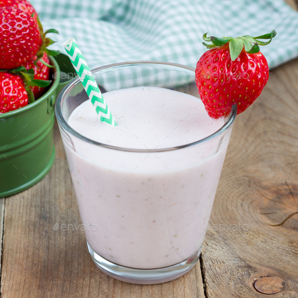 Healthy smoothie with strawberry, banana and yogurt in glass, square - Stock Photo - Images