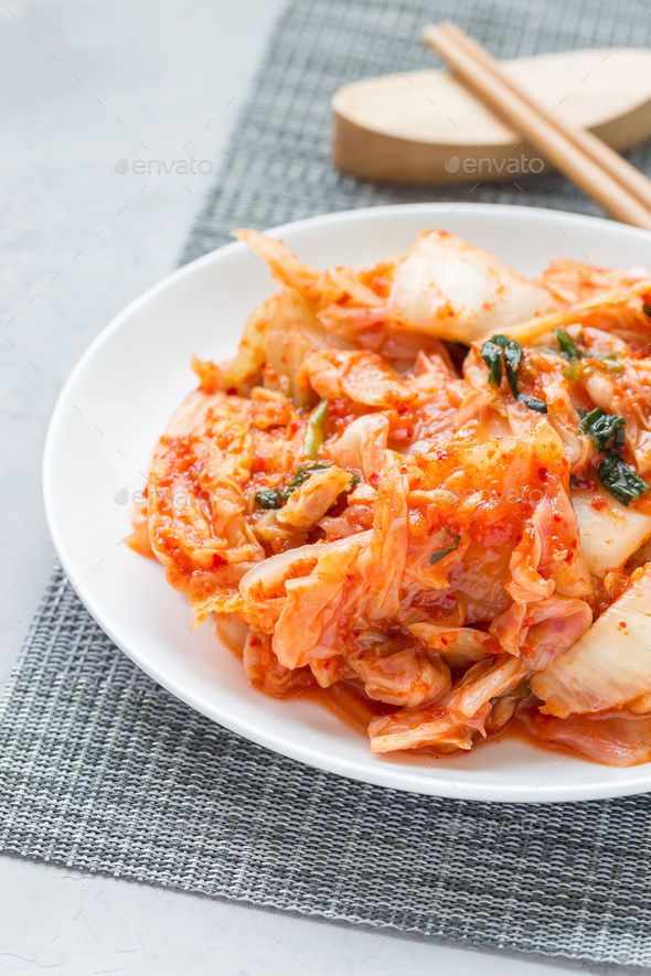 Kimchi cabbage. Korean appetizer on white plate, vertical - Stock Photo - Images