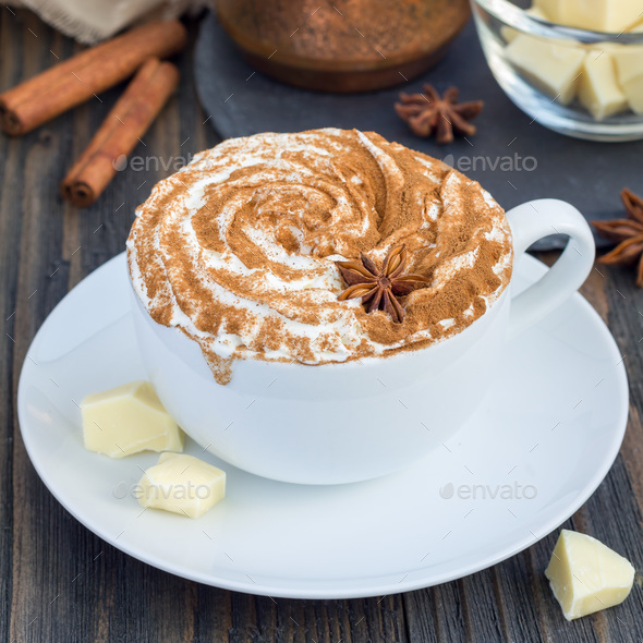 Hot white chocolate, decorated with whipped cream and cinnamon, square - Stock Photo - Images