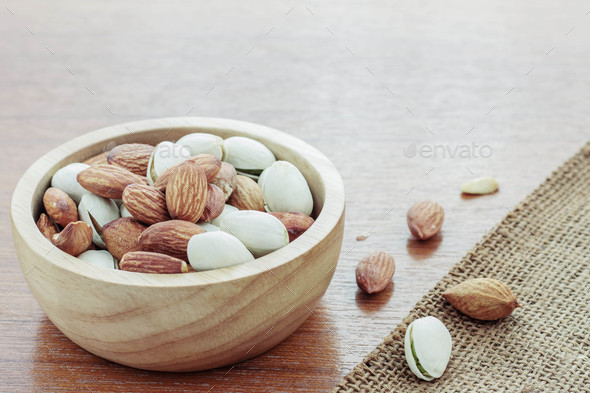 Almonds on wooden floor - Stock Photo - Images