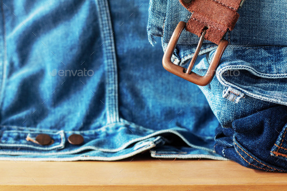 Belts and jeans on wooden - Stock Photo - Images