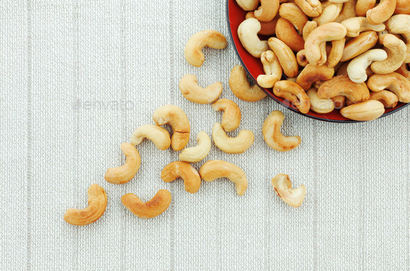 Cashew nuts roasted salt on tablecloth - Stock Photo - Images